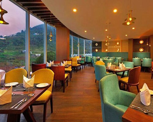 A fine dining area of Sterling Kodai resort with an outside view.