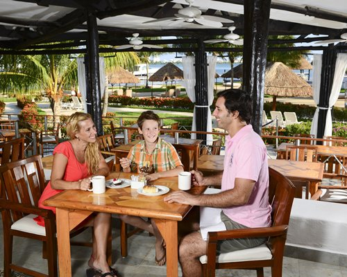 A family at a restaurant in Sunset Marina Resort and Yacht Club.