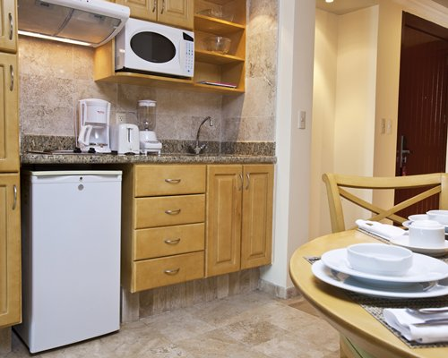 A well equipped kitchen with dishwasher and a microwave.