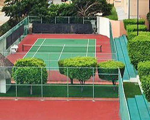 Outdoor recreation area with tennis court.