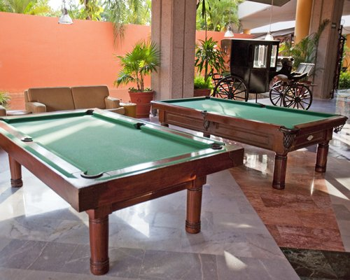 Indoor recreation area with two pool tables.