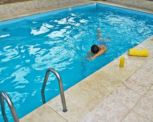 A boy swimming in the pool.
