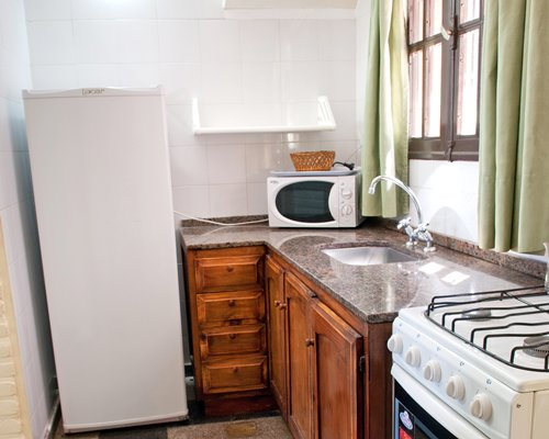 A well equipped kitchen with a microwave and refrigerator.