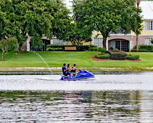 View of people riding a jet ski outside of the resort.