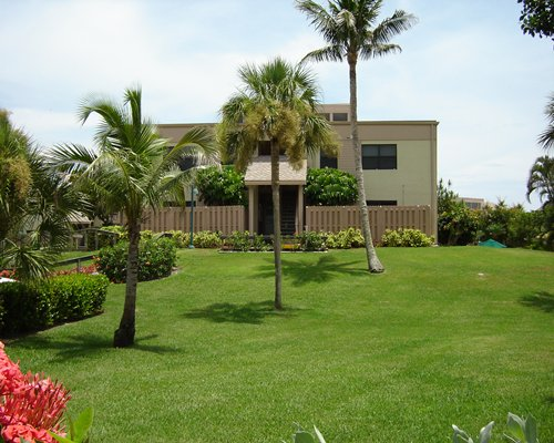Scenic exterior view of a unit at Sanibel Beach Club with golf course.