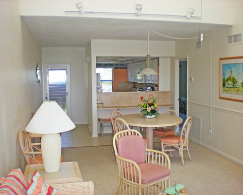 Furnished living room with open plan kitchen and dining area.