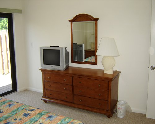 A well furnished bedroom with television and outdoor view.