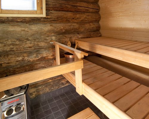 A wood paneled indoor steam room.
