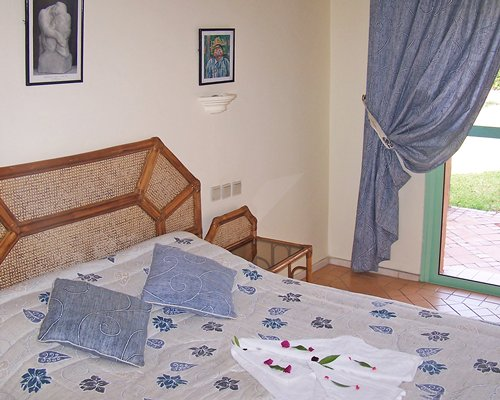 A well furnished bedroom with a patio.