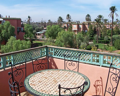 View of balcony with patio furniture.
