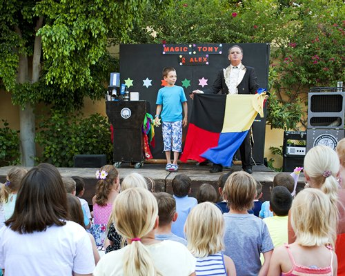 View of magic show for kids at Candia Park Village.