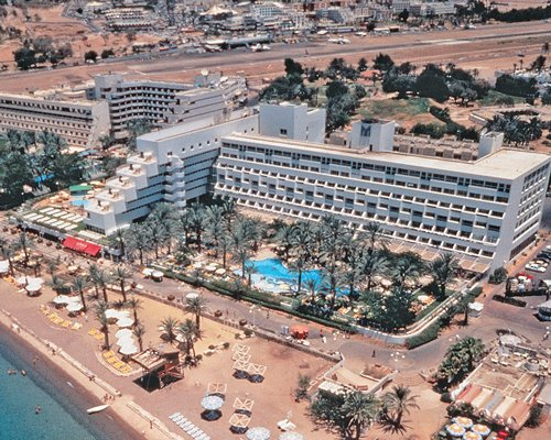 An aerial view of Leonardo Plaza Eilat with buildings alongside the beach.