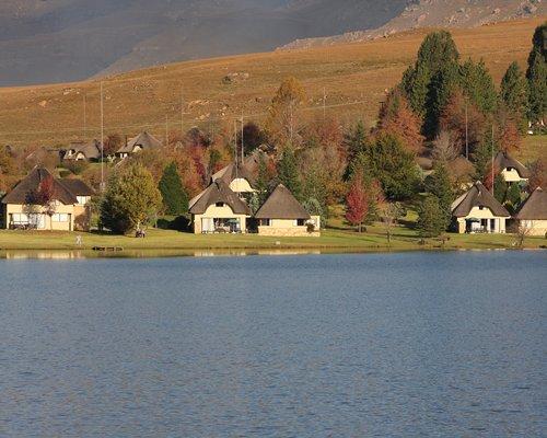 Scenic exterior view of multiple units at Castleburn alongside lake.