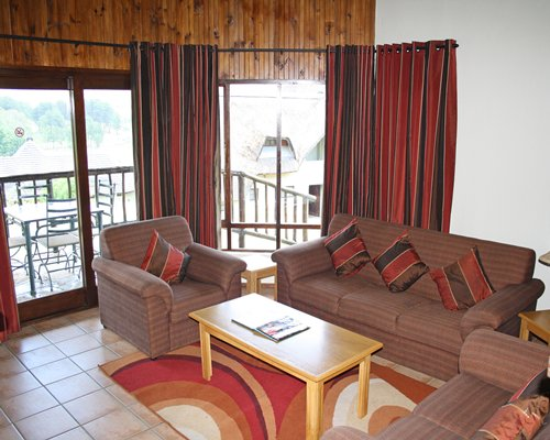 A well furnished living room with outdoor patio and patio furniture.
