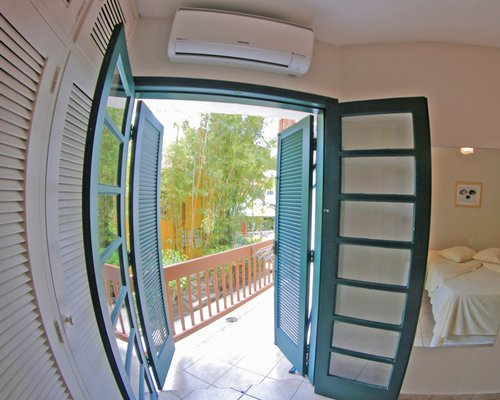 A fish eye view of outside from the bedroom with an air conditioner.