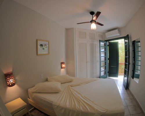 A well furnished bedroom with a double bed alongside an outdoor view.