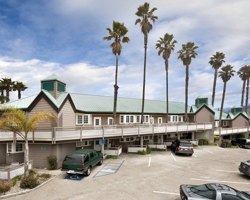 An exterior view of the WorldMark Pismo Beach resort alongside the parking lot.