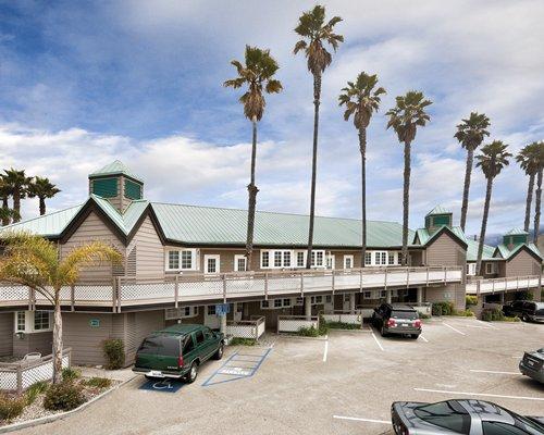 An exterior view of the WorldMark Pismo Beach resort alongside the parking lot.