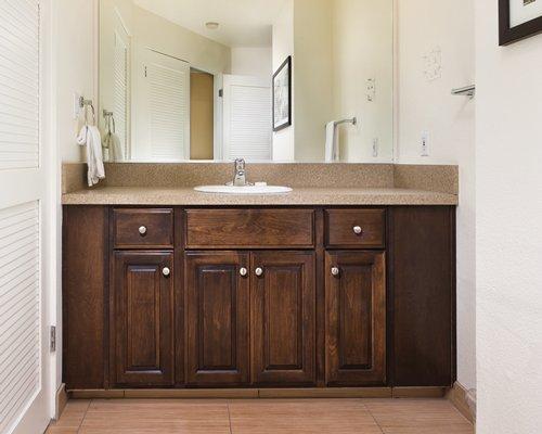 View of closed sink vanity.