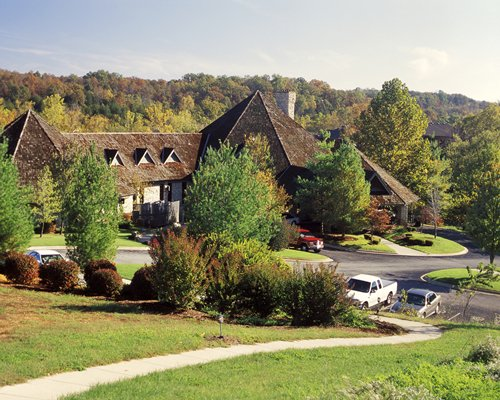 Scenic exterior view of Stonebridge Village Condominiums surrounded by wooded area.