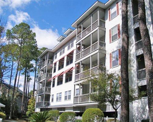Scenic exterior view of multiple unit balconies.