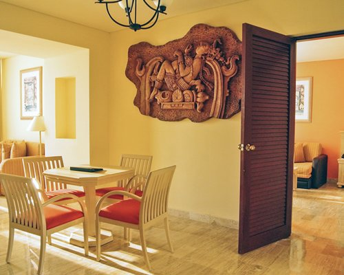 Dining area with wall sculpture.