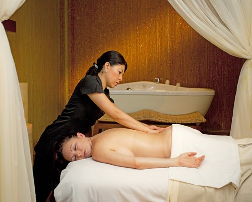 A man enjoying body massage in a spa.