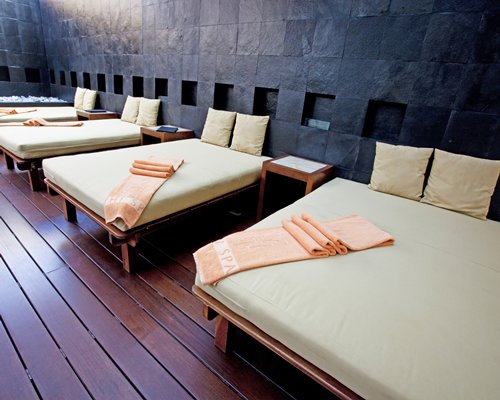 An indoor spa area with several beds.