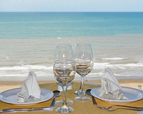 A dining area alongside the ocean.