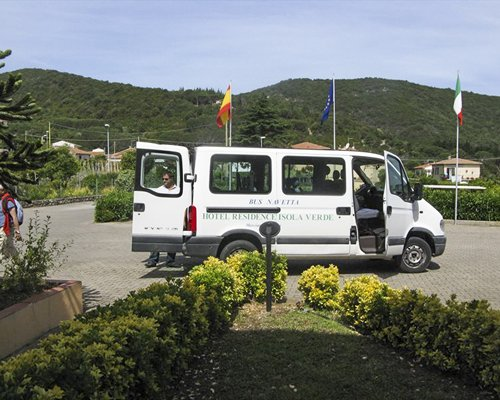 A van in the resort property alongside landscaping.