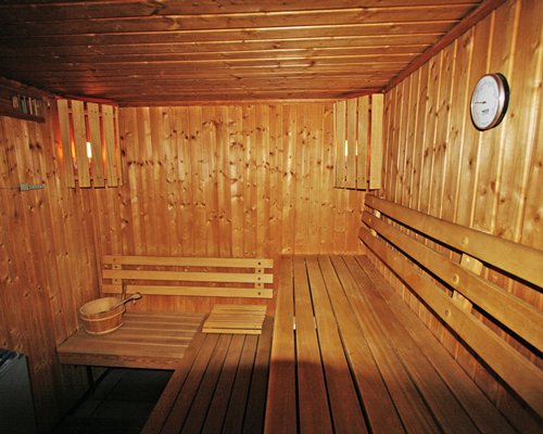 An indoor sauna at R≈Ωsidence Mont Calme resort.