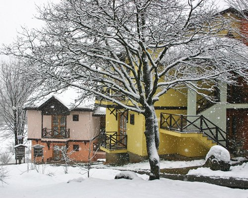 An exterior view of the Vonresort Abant resort covered by snow.