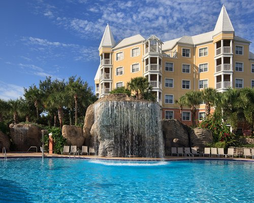 A view of an outdoor swimming pool alongside Hilton Grand Vacations Club At Seaworld resort.