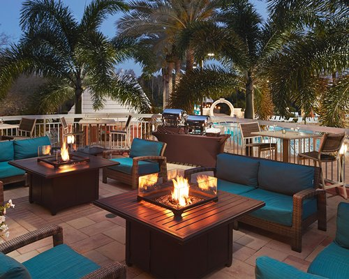 Resort lounge area with piano and fire in the fireplace.
