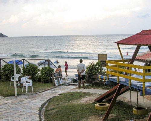 An outdoor recreational area alongside the ocean.