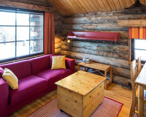 A well furnished wooden themed living area and an outside view.