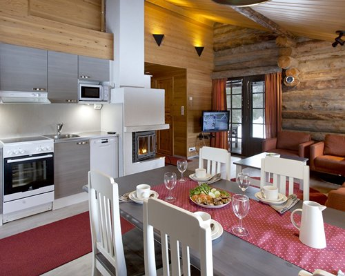 A well equipped kitchen with a fireplace.