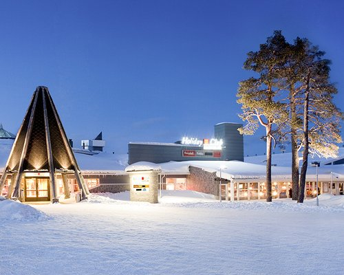 Exterior view of Holiday Club Saariselka resort at snow.