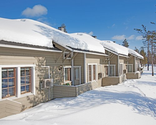 Exterior view of the Holiday Club Saariselka resort covered in snow.
