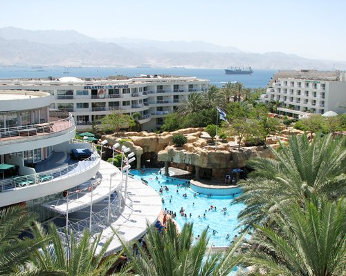 An aerial view of Club Hotel Eilat with an outdoor swimming pool alongside the gulf.