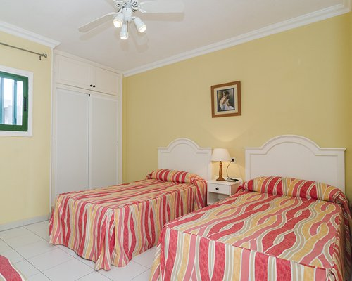 Furnished bedroom with two twin beds.