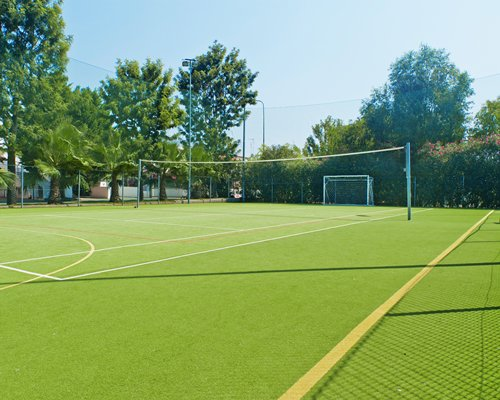An outdoor tennis and football court.