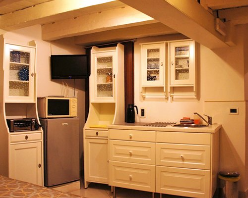 A well equipped kitchen with a television.