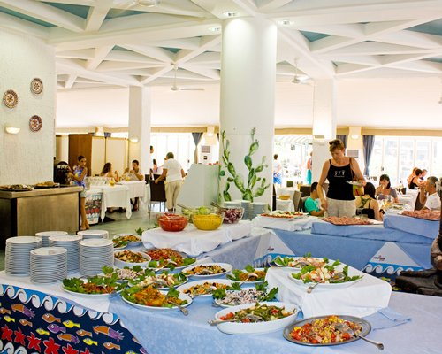 An indoor restaurant with buffet.