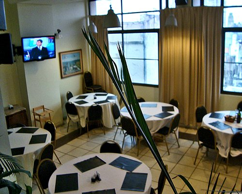 Indoor restaurant with television.