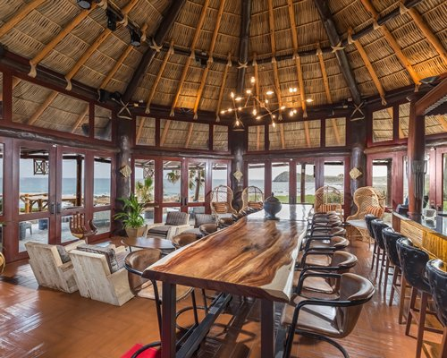 Indoor restaurant area with outside view at Hacienda del Mar Resort.