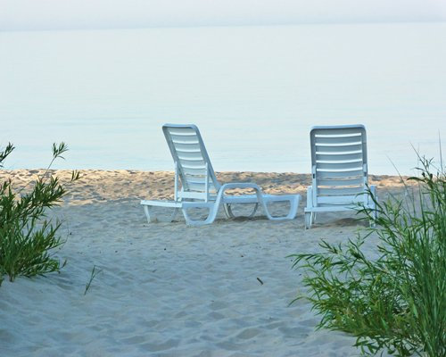 A view of chaise lounge chairs facing the beach.