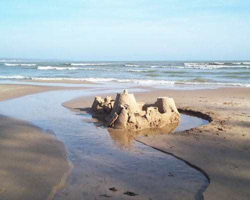A sand castle at the beach.