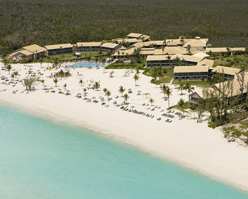 Birds eye view of the resort alongside the ocean.