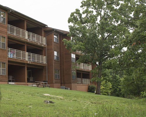 Exterior view of Still Waters Vacation Resort with a playground.